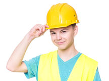 Αγόρι που φορά το κίτρινο σκληρό καπέλο Στοκ εικόνα με δικαίωμα ελεύθερης χρήσης