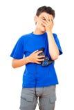 Αγόρι που χάνεται σε ένα τηλεοπτικό παιχνίδι Στοκ Εικόνα