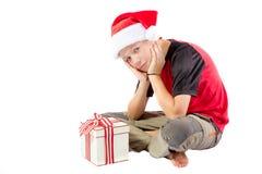 Αγόρι προ-εφήβων με ένα δώρο Χριστουγέννων Στοκ Φωτογραφία