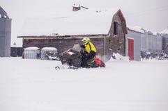 Αγόρι σε ένα όχημα για το χιόνι Στοκ εικόνες με δικαίωμα ελεύθερης χρήσης