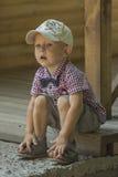 Αγόρι σε μια ΚΑΠ Στοκ Εικόνες