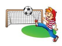 Αγόρι σε μια κόκκινη ΚΑΠ που κλωτσά μια σφαίρα ποδοσφαίρου Απεικόνιση αποθεμάτων