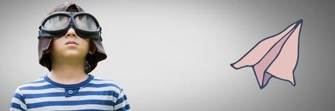 Αγόρι στο γκρίζο κλίμα με τα πειραματικά προστατευτικά δίοπτρα και το καπέλο Στοκ Εικόνα