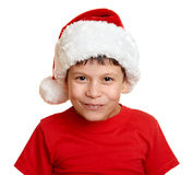 Αγόρι στο πορτρέτο καπέλων αρωγών santa - έννοια Χριστουγέννων χειμερινών διακοπών Στοκ φωτογραφία με δικαίωμα ελεύθερης χρήσης