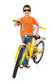 Αγόρι στο ποδήλατο που απομονώνεται Στοκ Φωτογραφίες