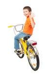 Αγόρι στο ποδήλατο που απομονώνεται Στοκ Φωτογραφία