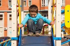 Αγόρι στο playgroung Στοκ φωτογραφία με δικαίωμα ελεύθερης χρήσης