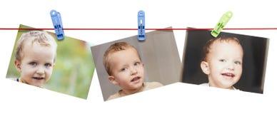 Αγόρι φωτογραφιών σε ένα σχοινί με ένα clothespin σε ένα άσπρο υπόβαθρο Στοκ εικόνες με δικαίωμα ελεύθερης χρήσης