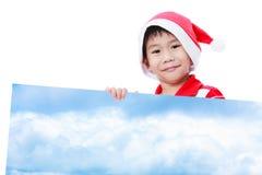 Αγόρι Χριστουγέννων με το κενό έμβλημα Στοκ εικόνες με δικαίωμα ελεύθερης χρήσης