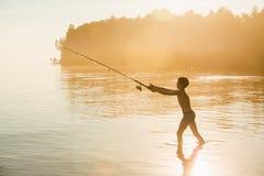 Αγόρι ψαράδων με την περιστροφή Στοκ Φωτογραφίες