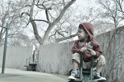 Αγόρι teeter totter Στοκ εικόνα με δικαίωμα ελεύθερης χρήσης