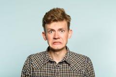 Αδέξια αδέξια fumbling dorky έκφραση του προσώπου ατόμων Στοκ Εικόνα