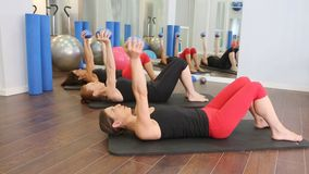Aerobic Pilates personal trainer in a gym group class Stock Footage