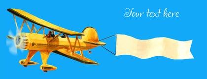 Αεροπλάνο με τη διαφήμιση ellow biplane με την άσπρη κορδέλλα στο μπλε ουρανό ελεύθερη απεικόνιση δικαιώματος