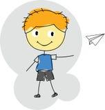 Αεροπλάνο εγγράφου παιχνιδιού αγοριών Στοκ εικόνα με δικαίωμα ελεύθερης χρήσης