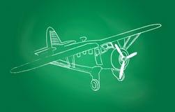 Αεροπλάνο πέρα από τον πίνακα κιμωλίας Στοκ Εικόνες