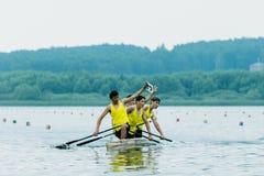 Αθλητής τέσσερα σε ένα καγιάκ Στοκ Φωτογραφίες