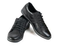 Αθλητικά παπούτσια των αρχικών μαύρων που απομονώνονται στο άσπρο υπόβαθρο Στοκ φωτογραφίες με δικαίωμα ελεύθερης χρήσης