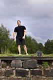 Αθλητικός τύπος και ρολόι Στοκ Φωτογραφία