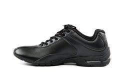 αθλητισμός παπουτσιών ατό& Πάνινα παπούτσια σε μια άσπρη ανασκόπηση Στοκ Φωτογραφίες