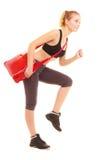 αθλητισμός Φίλαθλο κορίτσι ικανότητας με την τσάντα γυμναστικής που τρέχει στην κατάρτιση Στοκ φωτογραφίες με δικαίωμα ελεύθερης χρήσης