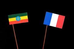 Αιθιοπική σημαία τη γαλλική σημαία που απομονώνεται με στο Μαύρο Στοκ Φωτογραφίες