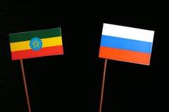 Αιθιοπική σημαία τη ρωσική σημαία που απομονώνεται με στο Μαύρο Στοκ Εικόνα