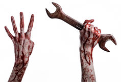 Αιματηρό χέρι που κρατά ένα μεγάλο γαλλικό κλειδί, αιματηρό γαλλικό κλειδί, μεγάλο βασικό, αιματηρό θέμα, θέμα αποκριών, τρελλό μ Στοκ εικόνα με δικαίωμα ελεύθερης χρήσης