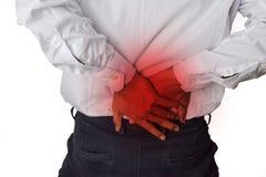 Αισθάνεται τον πόνο στο μικρό της πλάτης Πόνος στην πλάτη, φυσική ζημί στοκ εικόνα