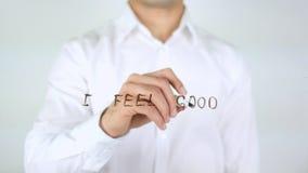 Αισθάνομαι το καλό, γράψιμο επιχειρηματιών στο γυαλί Στοκ Εικόνες