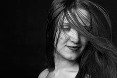 Αισθησιακό χαμόγελο γυναικών Στοκ Φωτογραφίες