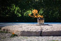 Αιώνια φλόγα John Φ Αναμνηστικό σοβαρό νεκροταφείο του Άρλινγκτον Kennedy Στοκ Φωτογραφίες