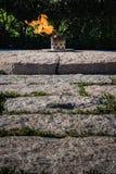 Αιώνια φλόγα John Φ Αναμνηστικό σοβαρό νεκροταφείο του Άρλινγκτον Kennedy Στοκ Εικόνες