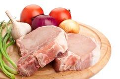 Ακατέργαστες μπριζόλες χοιρινού κρέατος Στοκ φωτογραφία με δικαίωμα ελεύθερης χρήσης