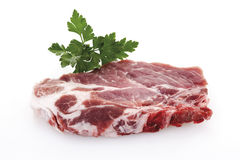 Ακατέργαστοι μπριζόλα και μαϊντανός χοιρινού κρέατος Στοκ Εικόνες