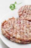 Ακατέργαστος τα burgers Στοκ Εικόνα