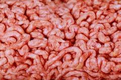 Ακατέργαστο επίγειο βόειο κρέας ως υπόβαθρο Στοκ Φωτογραφία