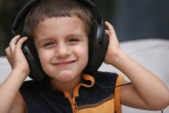 ακουστικά αγοριών Στοκ Εικόνα