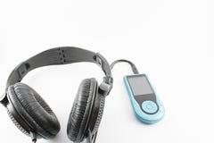 Ακουστικά και φορέας μουσικής Στοκ Εικόνες