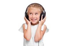 ακουστικά κοριτσιών λίγα Στοκ Εικόνες