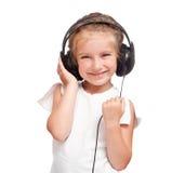 ακουστικά κοριτσιών λίγα Στοκ Φωτογραφίες