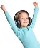 ακουστικά κοριτσιών λίγ&alp Στοκ φωτογραφία με δικαίωμα ελεύθερης χρήσης