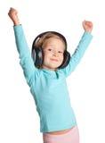 ακουστικά κοριτσιών λίγ&alp Στοκ φωτογραφίες με δικαίωμα ελεύθερης χρήσης