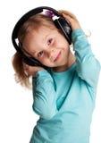 ακουστικά κοριτσιών λίγ&alp Στοκ Εικόνες