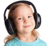 ακουστικά κοριτσιών λίγ&alp Στοκ εικόνα με δικαίωμα ελεύθερης χρήσης