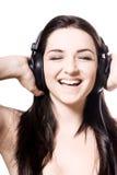 ακουστικά κοριτσιών πο&upsilo Στοκ εικόνα με δικαίωμα ελεύθερης χρήσης