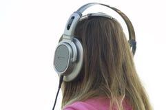 ακουστικά κοριτσιών Στοκ εικόνα με δικαίωμα ελεύθερης χρήσης