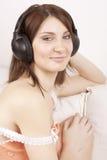 ακουστικά κοριτσιών Στοκ φωτογραφία με δικαίωμα ελεύθερης χρήσης