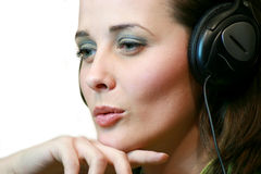 ακουστικά κοριτσιών Στοκ Φωτογραφίες