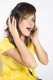 ακουστικά κοριτσιών Στοκ Εικόνες